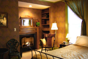 Astor House room with fireplace