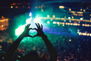 Music concerts with heart shaped hands
